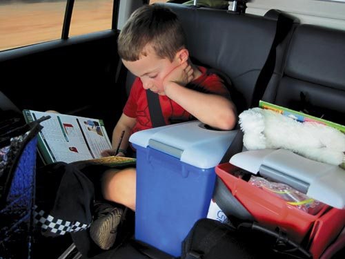 Boy Reading In Car