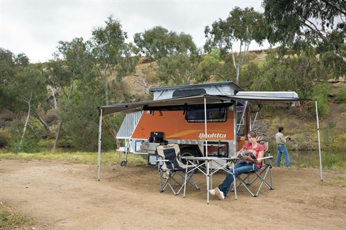 Woman camping with a camper trailer by Quokka Toy Hauler