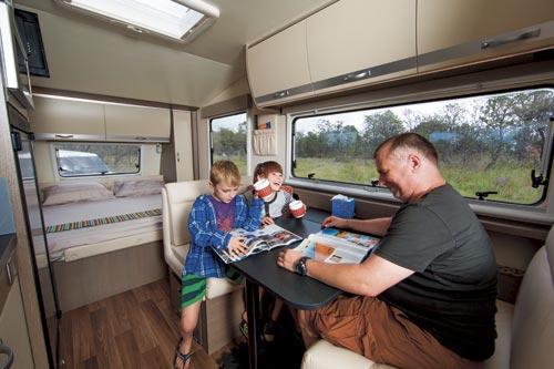 Family Sitting Inside Avida Sapphire 6616D Caravan