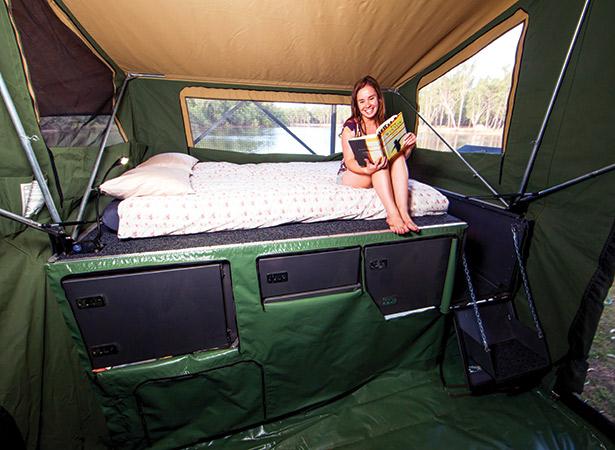 Girl Reading In Camper Trailer