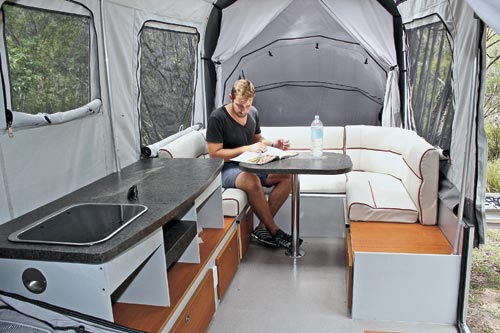 Man Sitting In Camper Trailer
