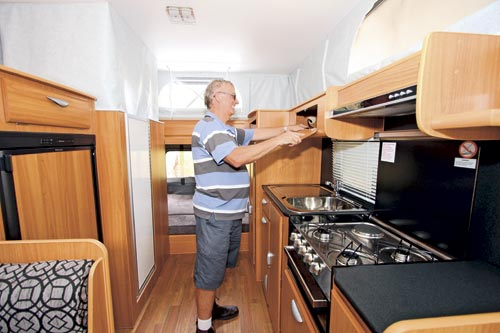 Man In The Windsor Rapid Caravan Kitchen