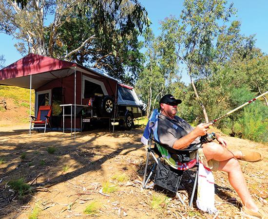 Camper Trailer Man Fishing