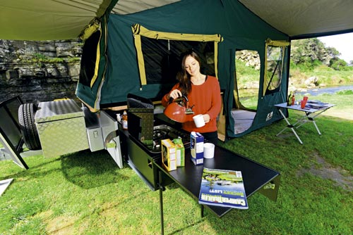 Woman Cooking In A Camper Trailer Kitchen