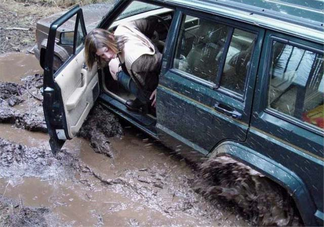 Woman And 4wd Stuck In The Mud