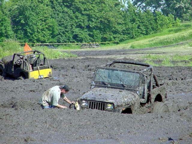 Man And 4wd Stuck In The Mud