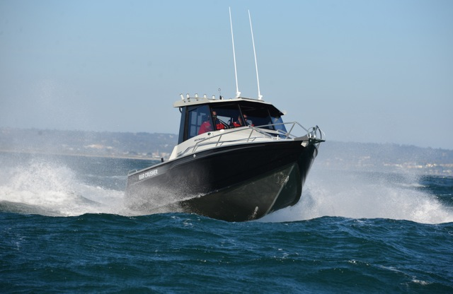 Bar Crusher Hardtop Pilothouse boat on the water