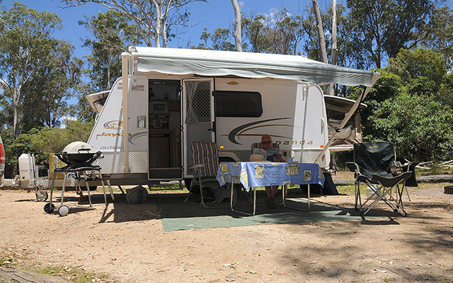 Man Camping In A Jayco Expanda Caravan