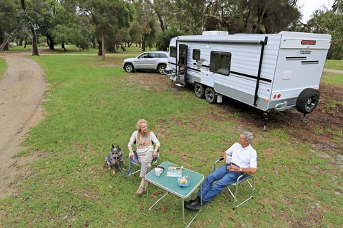 Couple And Their Caravan