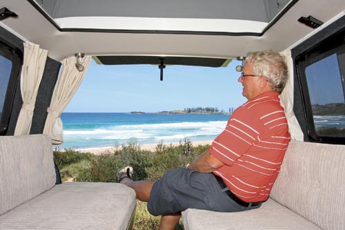 Man Sitting In Campervan