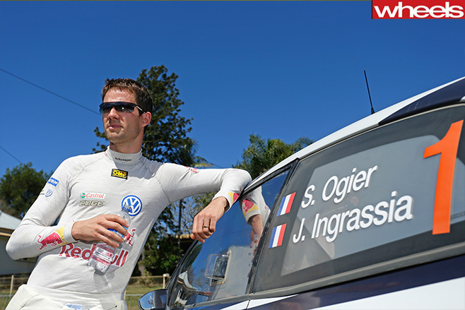 Sebastien -Ogier -standing -outside -his -car