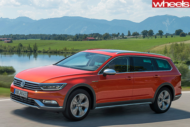 Red -Volkswagen -Passat -Alltrack -side-