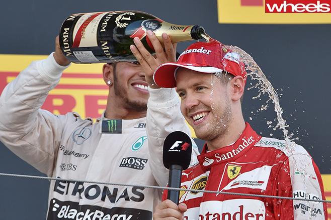 Lewis -Hamilton -pours -champagne -over -Ferrari -rival