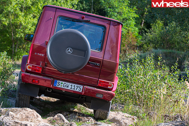 Mercedes -G500-rear -climbing -over -rocks