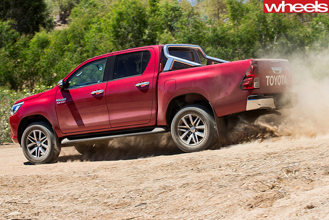 Toyota -Hilux -Range -driving -on -dirt