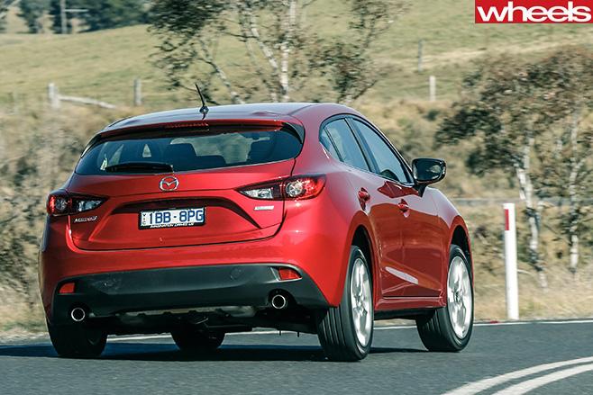 Mazda -3-driving -rear