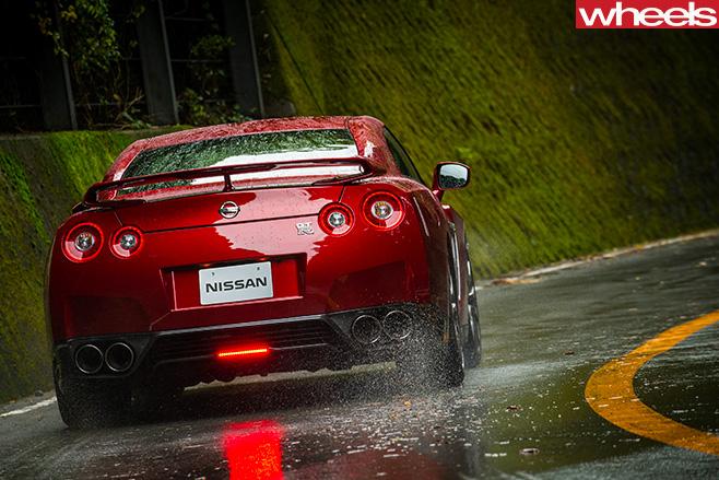 Nissan -GT-R-rear -driving -in -rain