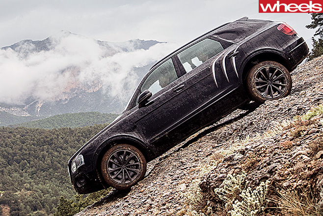 Bentley -Bentayga -driving -down -hill