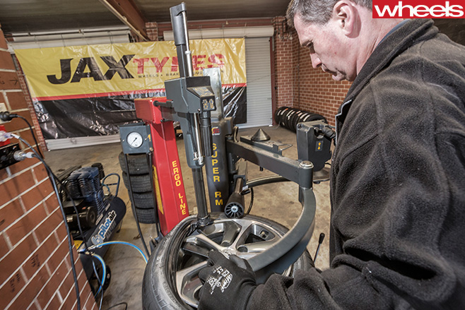 Mechanic -stripping -and -fitting -tyres -to -wheels