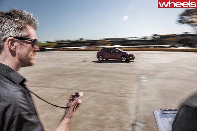 Man -timing -car -around -test -track