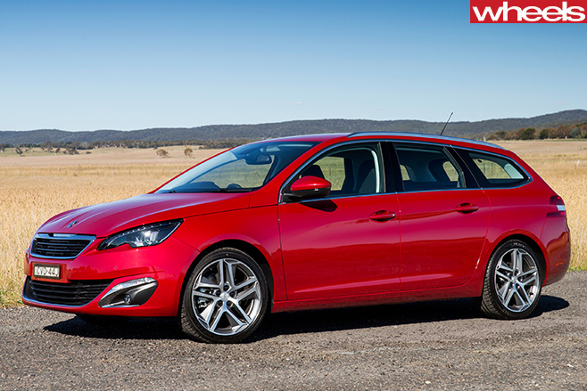 Peugeot -308-front -side -on -gravel -road