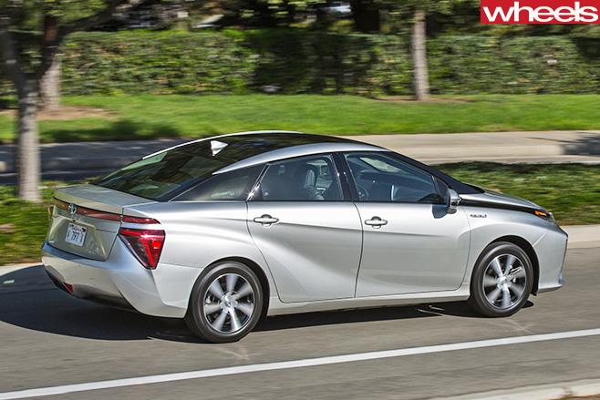 Silver -Toyota -Mirai -driving -rear