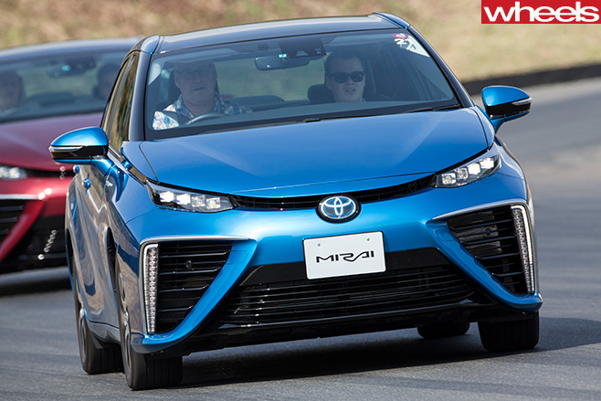 Blue -Toyota -Mirai -hydrogen -fuel -cell -vehicle -entering -corner-