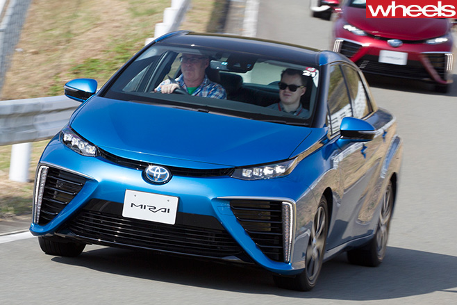 Blue -Toyota -Mirai -hydrogen -fuel -cell -vehicle -entering -corner -driving