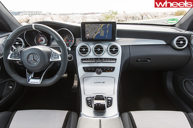 Mercedes -C63-Amg -Coupe -driving -rear