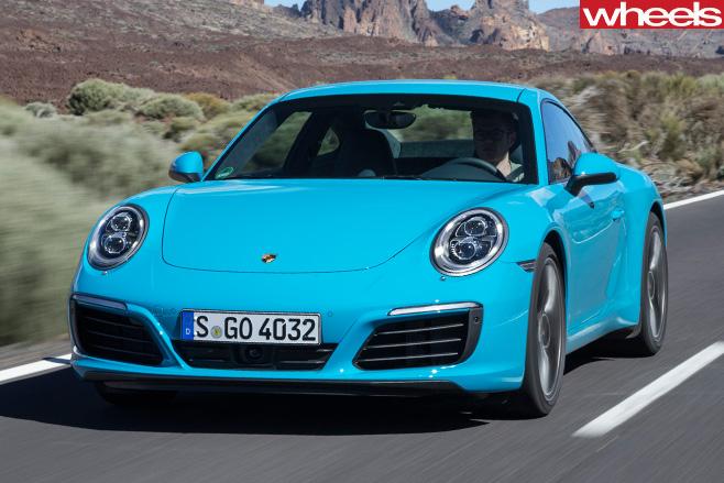 Porsche -911-Carerra -front -side -driving -road