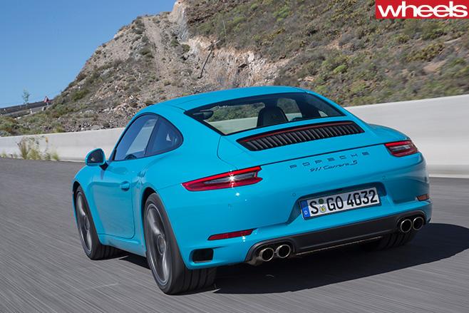 2016-Porsche -911-Carerra -rear -side -driving