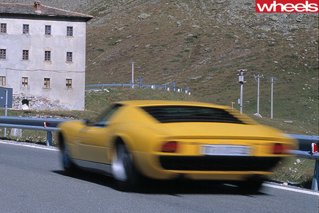 Yellow -Lamborghini -Muira -driving -rear