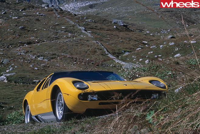 Yellow -Lamborghini -Muira -front -driving -up -hill