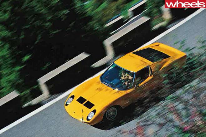 Yellow -Lamborghini -Muira -front -driving -road -top -side
