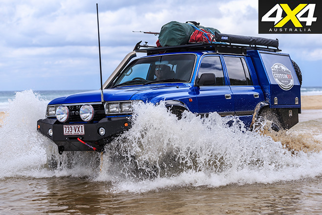 Custom toyota 80-series land cruiser driving water