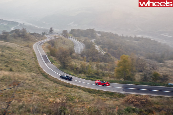 Mc Laren -vs -Ferrari -driving -road-