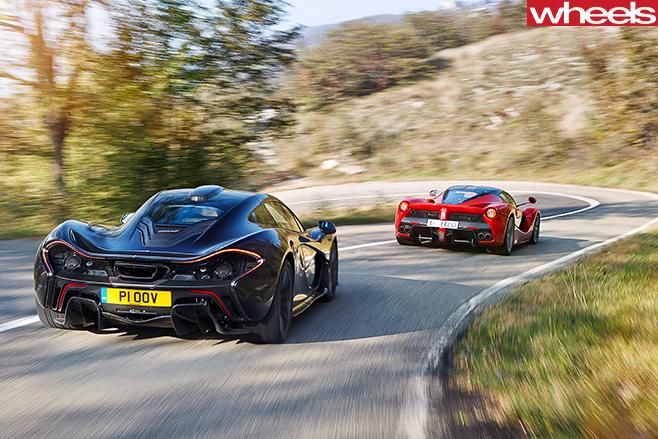 Mc Laren -vs -Ferrari -entering -bend