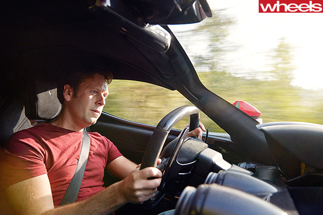 Mc Laren -vs -Ferrari -driving -front