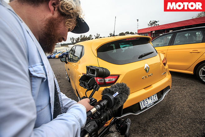 Camera guy filming cars