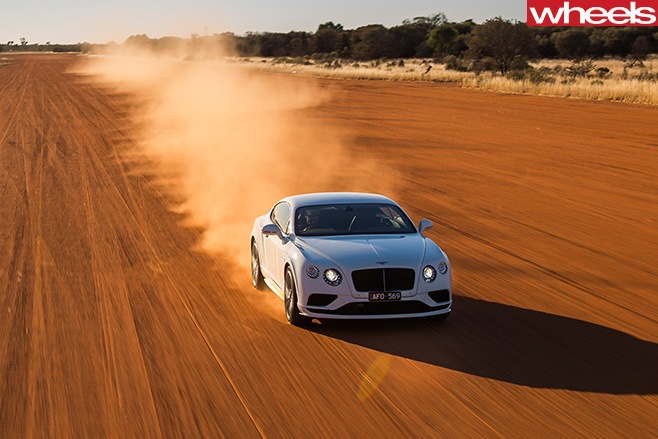 Bentley -driving -dirt -road