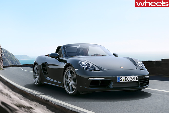 Grey -Porsche -Boxster -driving -front