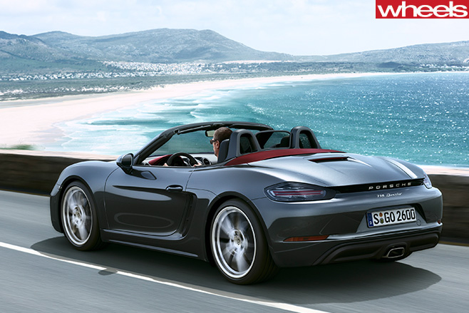 Grey -Porsche -Boxster -driving -rear