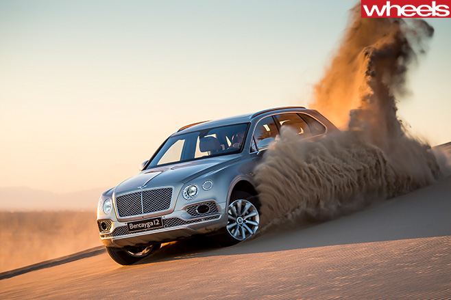 Bentley -Bentayga -driving -sand -driving -down -front -side
