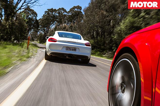Porsche cayman in front audi tt s