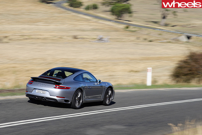 Porsche -911-Carerra -C2-S-Coupe -driving -side -rear