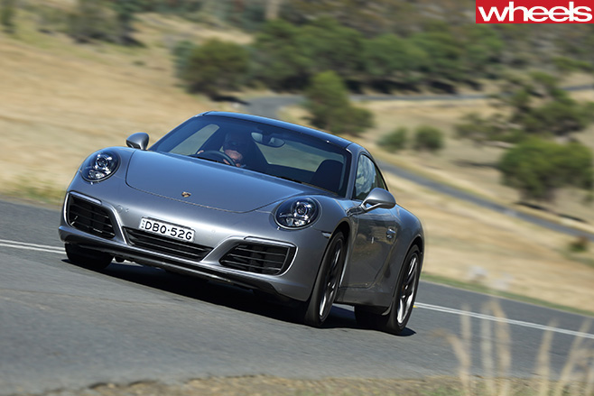 Porsche -911-Carerra -C2-S-Coupe -driving -front -side