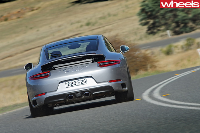 Porsche -911-Carerra -C2-S-Coupe -driving -rear -corner