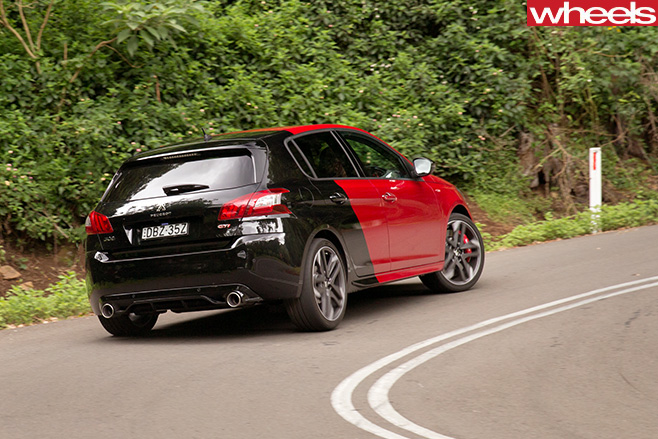 Peugeot -308-gti -driving -rear-