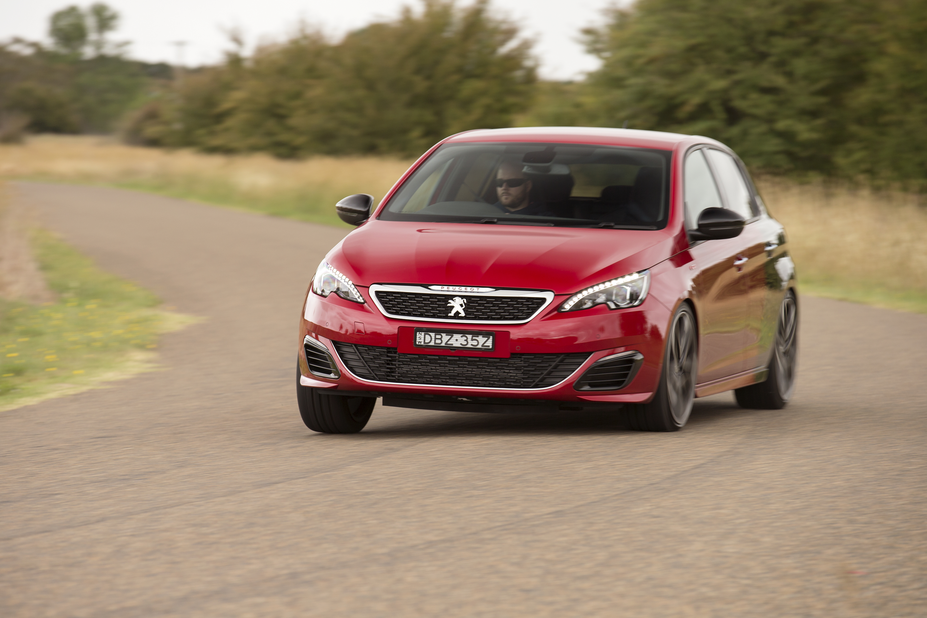 Peugeot -308-gti -driving -front -side