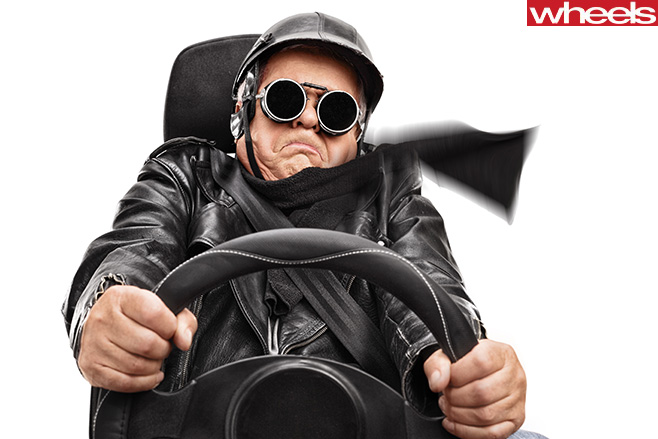 Elderly -man -holding -steering -wheel